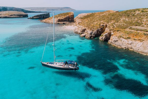 Aerial of Yacht in Blue Lagoon, off Comino-min-2
